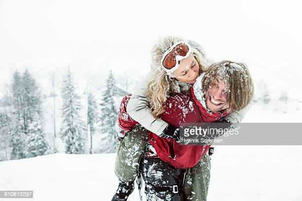 young couple in the snow - cougar woman fotografías e imágenes de stock