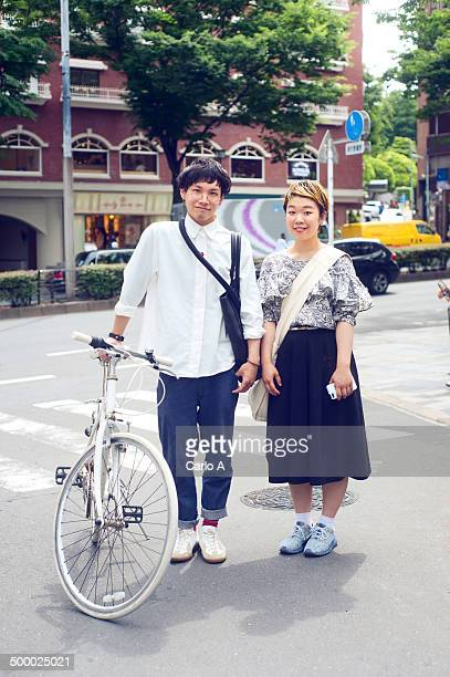young couple in tokyo - posing shoes ストックフォトと画像
