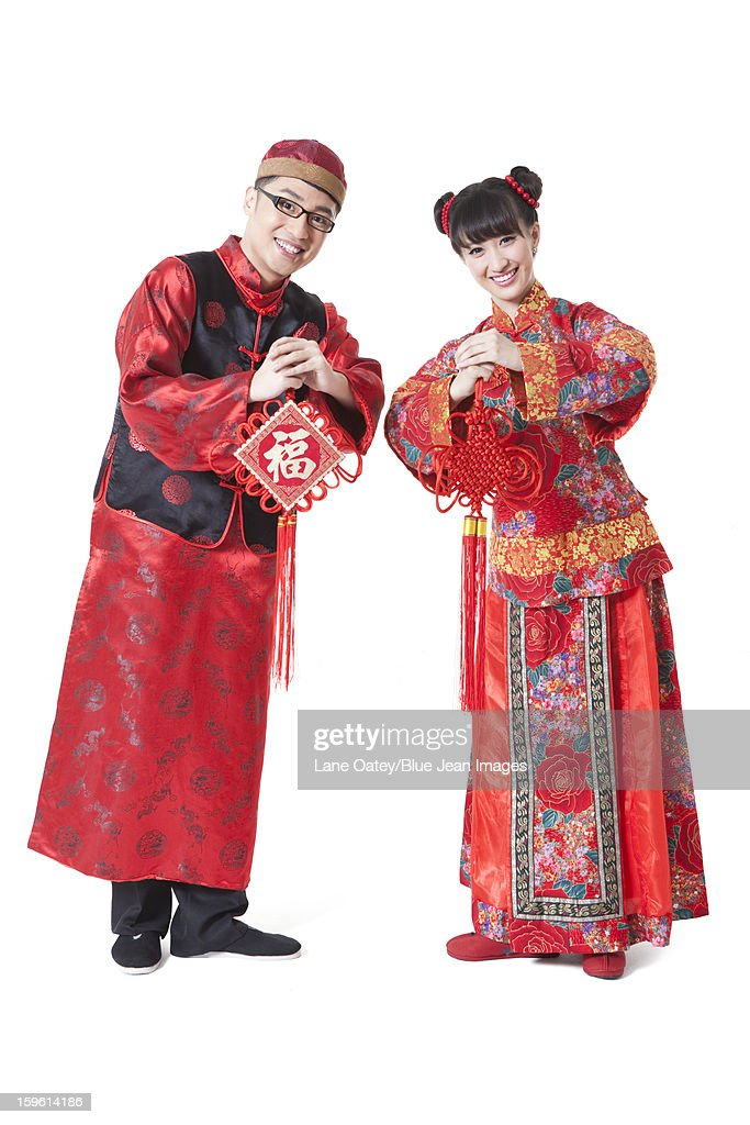 Young couple in traditional chinese clothing greeting for chinese young couple in traditional chinese clothing greeting for chinese new year stock photo m4hsunfo