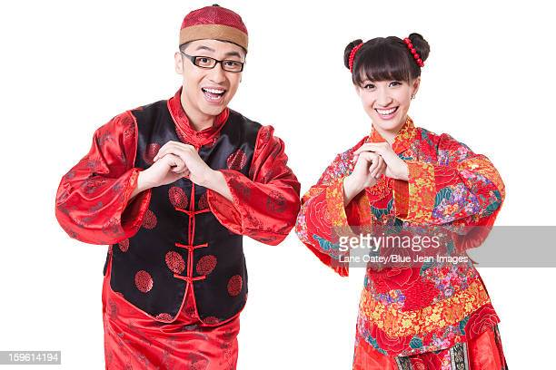 Chinese welcome new year stock photos and pictures getty images young couple in traditional chinese clothing greeting for chinese new year m4hsunfo
