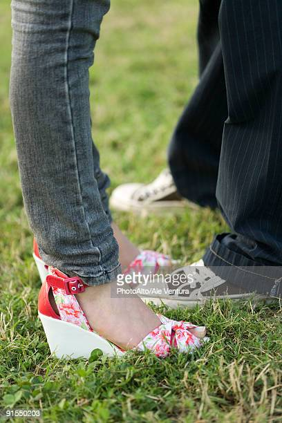 young couple in trendy clothing standing face to face, low section - heterosexuelles paar stock-fotos und bilder
