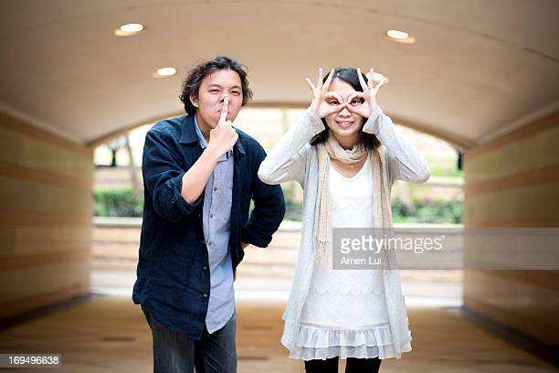 Young Couple in Tunnel playing wry face