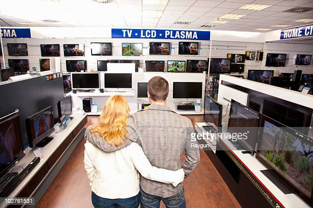 Young Couple in TV section