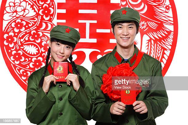young couple in uniform - uvula stock photos and pictures