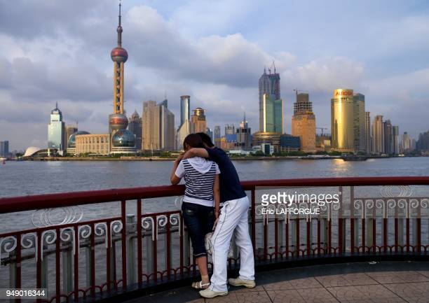 Young couple inlove in front of jinmao tower and oriental pearl tower shanghai China on June 11 2007 in Shanghai China