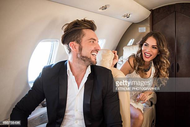 Young couple inside private aeroplane