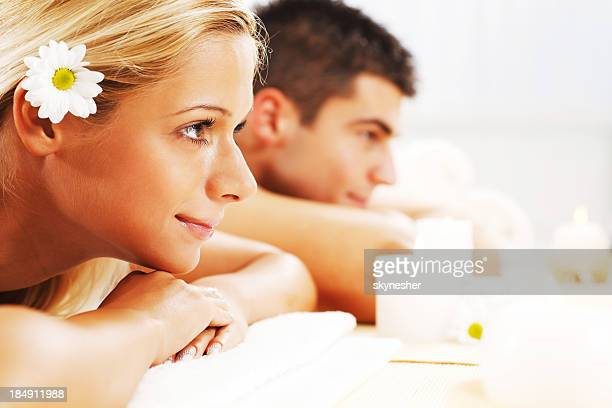 Young couple is enjoying at spa centre.