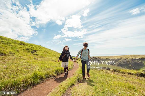 A young couple is hiking