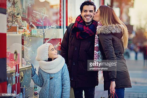 Young couple is kissing at the street at Xmas
