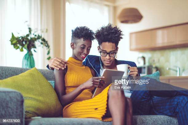 Young couple is listening music at home