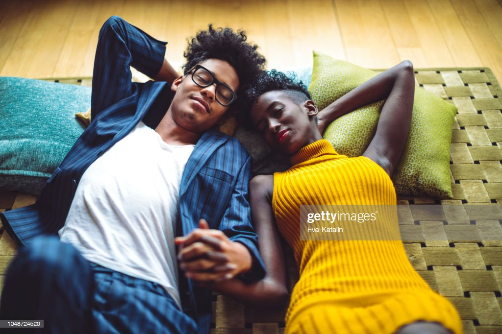 Young couple is relaxing on the floor in their new flat : Stock Photo