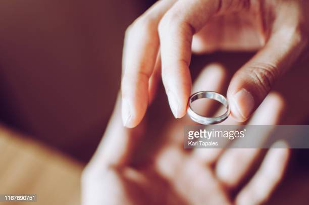 a young couple is returning back their wedding ring, a concept of relationship difficulties - white gold stock pictures, royalty-free photos & images