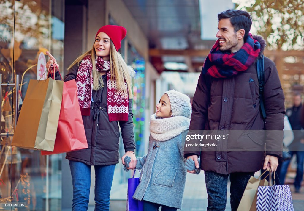 Young couple is shopping at Christmas : Stock Photo