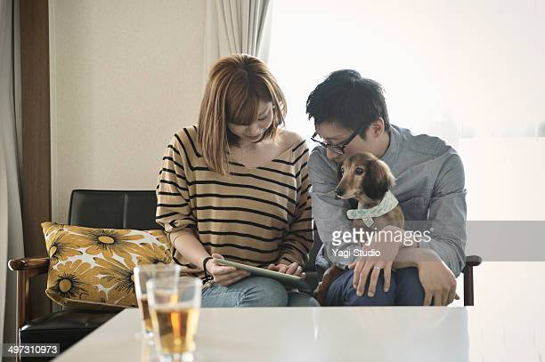 Young couple is using a digital tablet