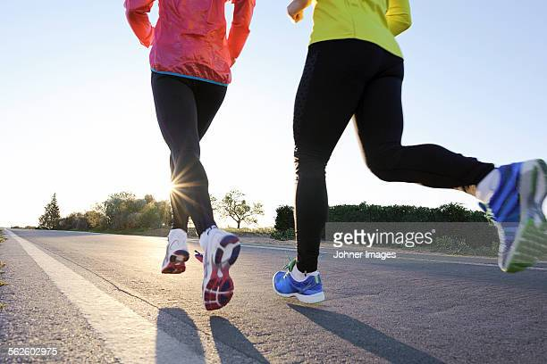 young couple jogging - morning stock pictures, royalty-free photos & images