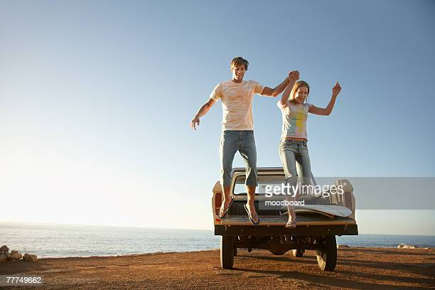 Young Couple Jumping from a Flatbed