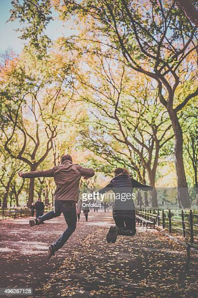 Young Couple Jumping in Central Park, NYC