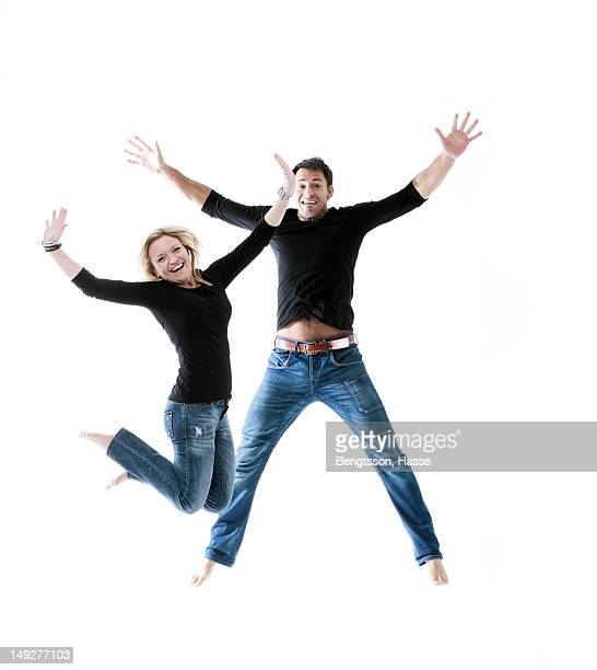 Young couple jumping together in joy