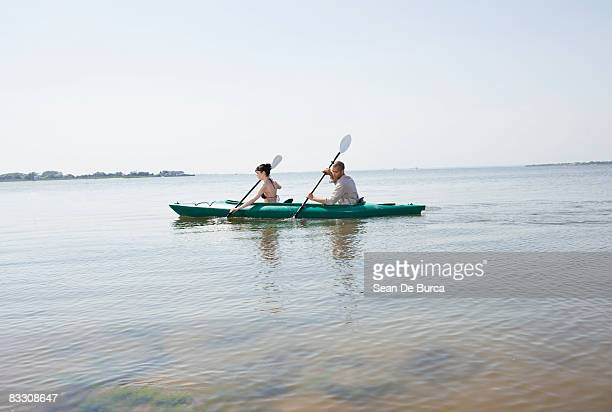 Young couple kayaking in inlet