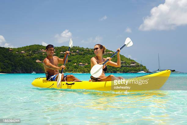young couple kayaking in the Caribbean