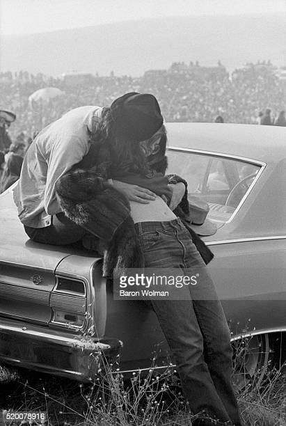 Young couple kiss at the Altamont Speedway Free Festival in Northern California held on Saturday December 6 1969