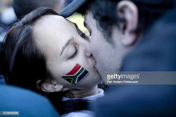 A young couple kiss during a game between South Africa and France shown on giant monitors on June 22 in central Cape Town South Africa Thousands of...