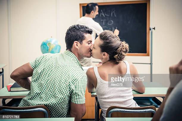 Young Couple Kissing at School