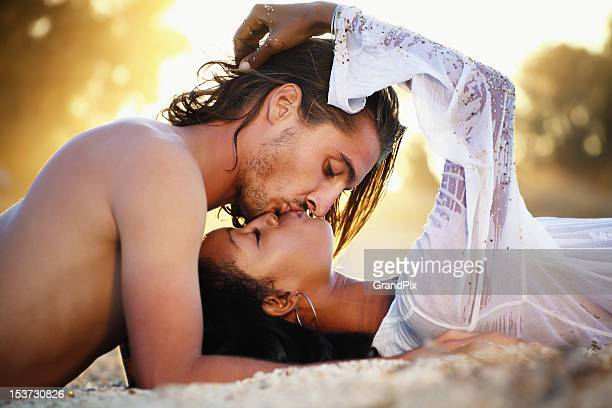 young couple kissing at sunset - peck stock pictures, royalty-free photos & images