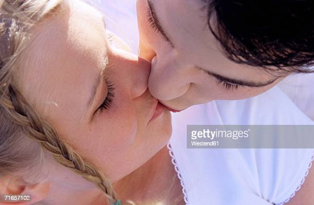 young couple kissing, close-up - bacio sulla bocca foto e immagini stock