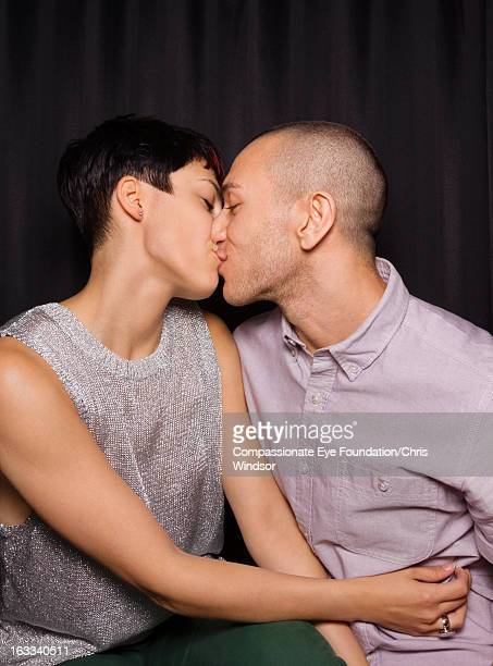 Young couple kissing in photo booth