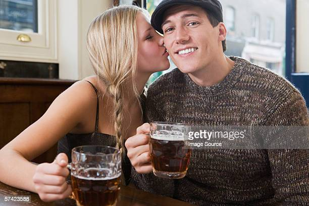 Young couple kissing in pub