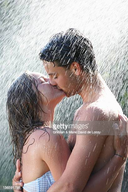 Young couple kissing in rain