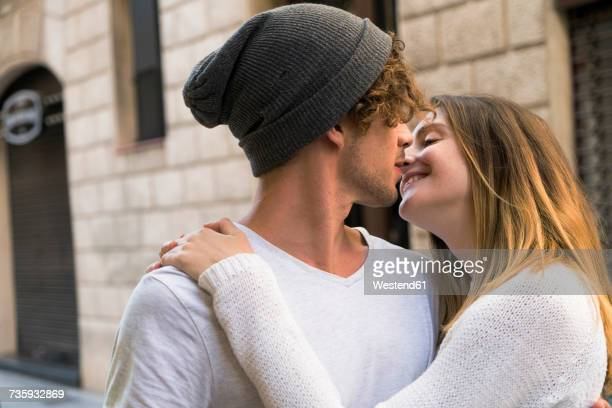 Young couple kissing in the city