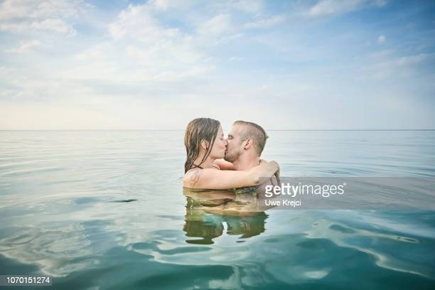 Young couple kissing in the water