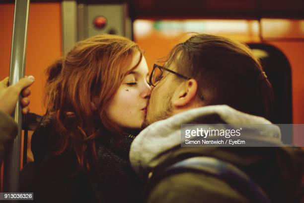 Young Couple Kissing In Train