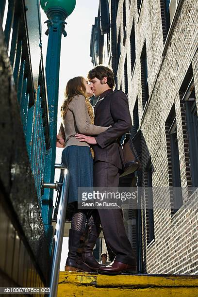 Young couple kissing, low angle view