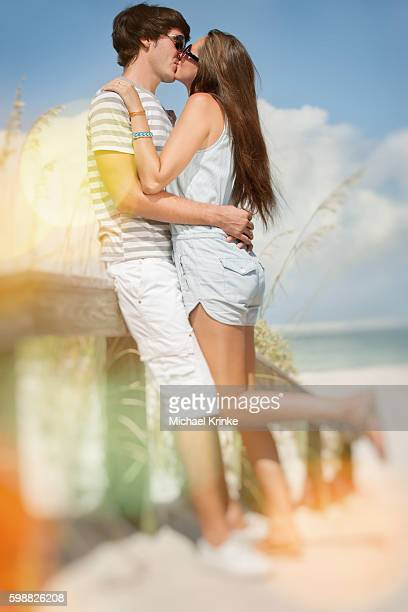 young couple kissing. - kiss lips stock pictures, royalty-free photos & images