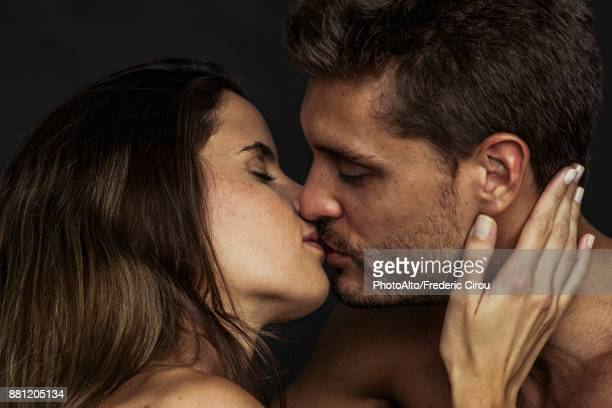 young couple kissing - male female nude stock pictures, royalty-free photos & images