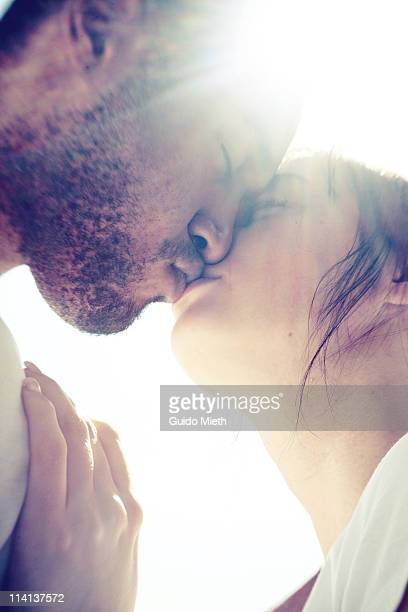 Young couple kissing softly