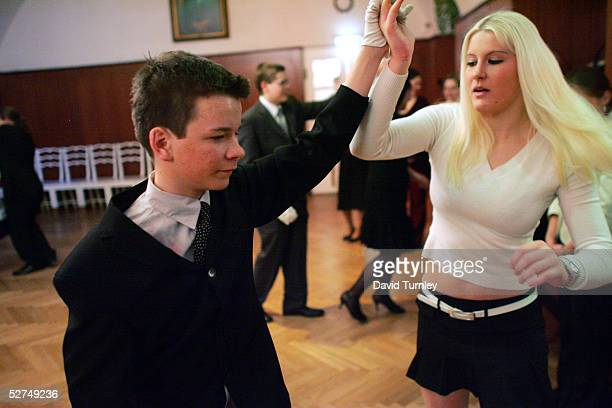 A young couple learn how to waltz at the famous Elmayer School on March 18 2005 in Vienna Austria The students of the Elmayer School are children of...