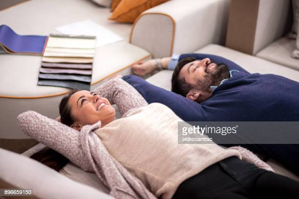 Young couple lie down on the bed