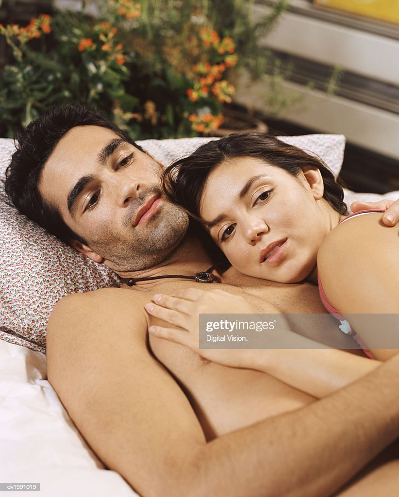 Young Couple Lie in Bed, Embracing : Stock Photo