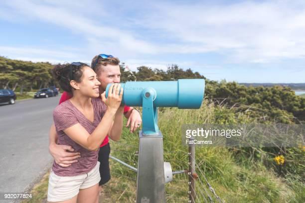 Young Couple Look Through a Telescope at an Oregon Beach Viewpoint