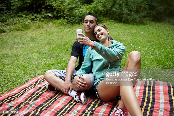 Young couple looking at a cell phone together