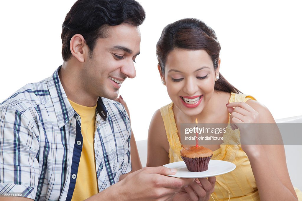Young couple looking at a cupcake : Stock Photo