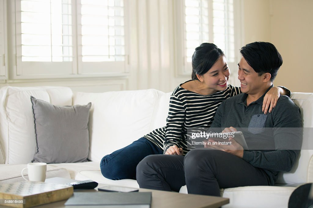Young couple looking at a digital tablet at home : 圖庫照片