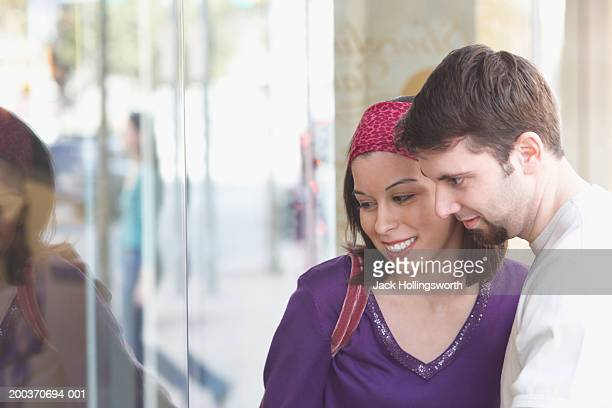 Young couple looking at a shop window