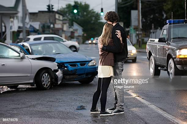 young couple looking at crashed cars - accident de la route photos et images de collection