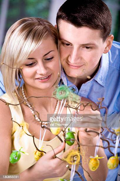 young couple looking at easter decorations - happy resurrection day stock pictures, royalty-free photos & images