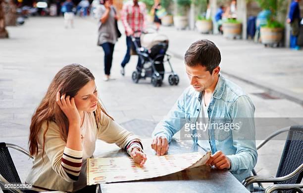 Young couple looking at menu in restaurant